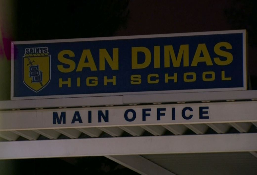 A pair of San Dimas High School students have been arrested for allegedly hacking into their school computer network to change grades.