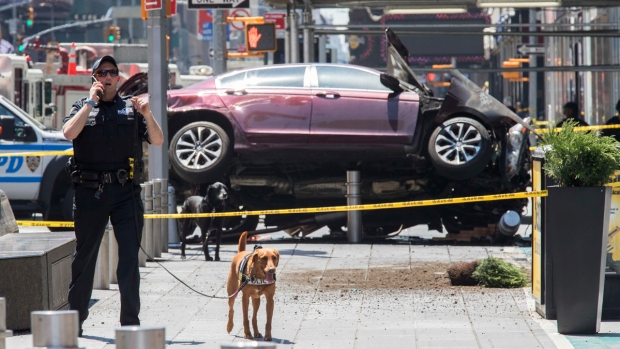 [NATL-NY] In Pictures: Car Slams into Crowd in Times Square