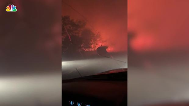 Father Comforts Daughter in Car as They Flee Calif. Fire