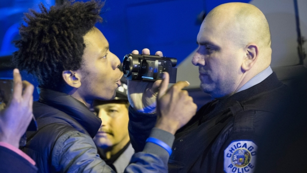 [NATL] Images Capture Tense Moment Between Protesters, Police