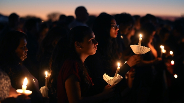 Grieving Community Remembers High School Shooting Victims