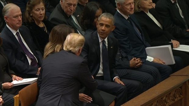 [NATL] Trumps, Obamas Shake Hands at Bush Funeral