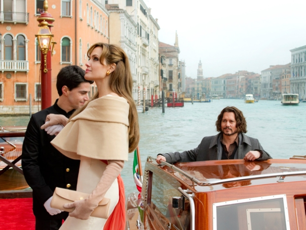 "First Pic From ""The Tourist"" Shows Depp Working ""Lovesick Hobo"" Look"