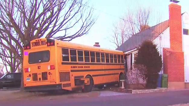 Driver Injured After Bus Crashes into Meriden Home