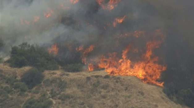 Wind-Driven Summit Fire Threatens Homes in Banning