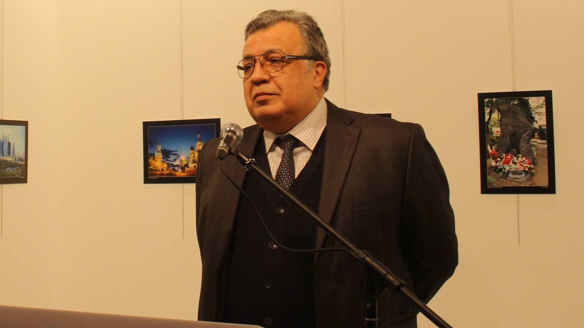 Russian Ambassador to Turkey, Andrey Karlov gives a speech as he visits an art fair at Modern Art Center in Ankara, Turkey, on December 19, 2016. He was shot at the exhibition while delivering a speech, according to reports from the scene. (Photo by Ecenur Colak/Anadolu Agency/Getty Images)