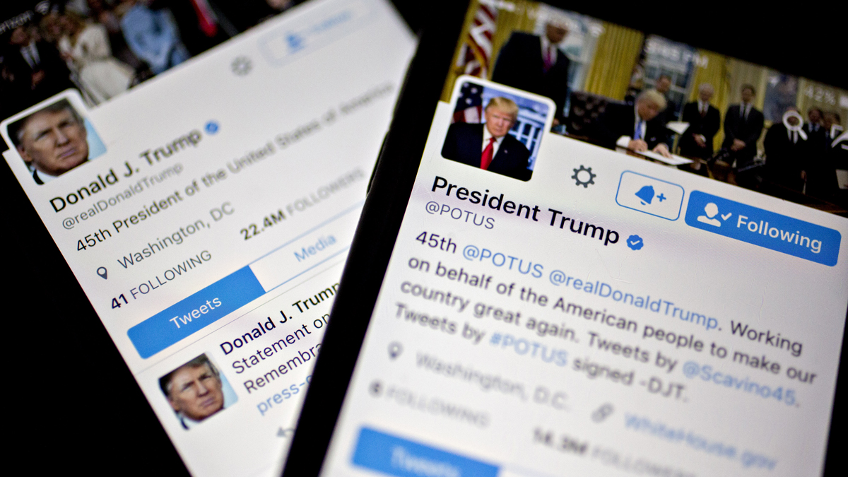 The Twitter Inc. accounts of President Donald Trump, @POTUS and @realDoanldTrump, are seen on an iPhone arranged for a photograph in Washington, D.C., on Friday, Jan. 27, 2017.