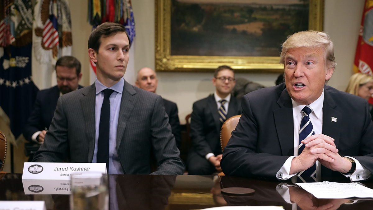 President Donald Trump (right) delivers remarks at the beginning of a meeting with his son-in-law and senior adviser Jared Kushner and government cyber security experts at the White House on Jan. 31, 2017. Kushner has volunteered to be interviewed in a Senate inquiry into possible ties between associates of Trump and Russian operatives. (Photo by Chip Somodevilla/Getty Images)