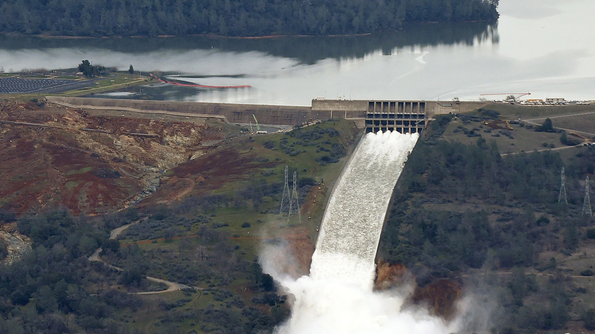Riverbend Park and the Oroville Dam's spillways are seen in Oroville, California on Monday, Feb. 13, 2017. Almost 200,000 people were under evacuation orders in Northern California Monday after a threat of catastrophic failure at the United States' tallest dam. Officials said the threat had subsided for the moment as water levels at the Oroville Dam, 75 miles north of Sacramento, have eased. But people were still being told to stay out of the area.(JOSH EDELSON/AFP/Getty Images)