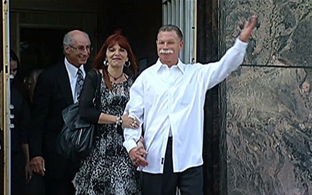 Daniel Larsen, who spent 13 years in prison for a crime he said he didn't commit was released from custody on Tuesday, March 19, 2013. He's seen here walking out of a federal court in Los Angeles accompanied by his wife and a co-director of the California Innocence Project, which helped in Larsen's case.
