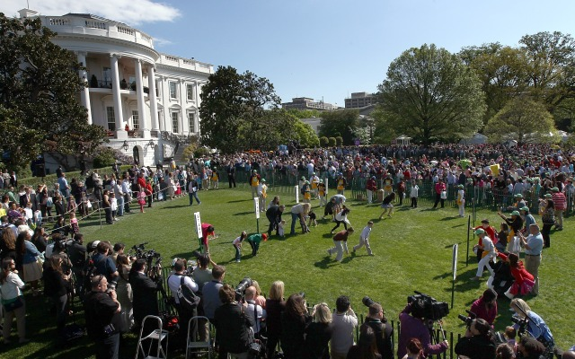 WASHINGTON, DC - APRIL 09:  Crowds of children and their families take part in the White House Easter Egg Roll on the South Lawn of the White House April 9, 2012 in Washington, DC. (Photo by Win McNamee/Getty Images)