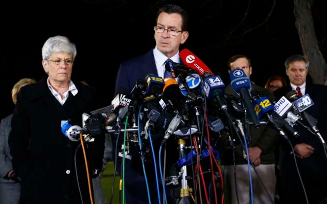 NEWTOWN, CT - DECEMBER 14:  Connecticut Gov. Dan Malloy and Lt. Gov. Nancy Wyman brief the media on the elementary school shootings during a press conference at Treadwell Memorial Park on December 14, 2012 in Newtown, Connecticut. Twenty-seven are dead, including 20 children, after a gunman identified as Adam Lanza in news reports, opened fire in Sandy Hook Elementary School in Newton. Lanza also reportedly died at the scene.  (Photo by Jared Wickerham/Getty Images)