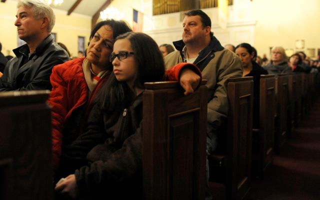 Mourners gather inside the St. Rose of Lima Roman Catholic Church at a vigil service for victims of the Sandy Hook School shooting.