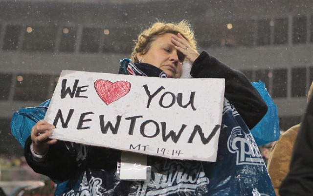 FOXBORO, MA - DECEMBER 16: A New England Patriots fan shows support for the 26 victims of the mass shooting that took place at Sandy Hook elementary school in Newtown, Connecticut before the game against the San Francisco 49ers at Gillette Stadium on December 16, 2012 in Foxboro, Massachusetts. (Photo by Jim Rogash/Getty Images)
