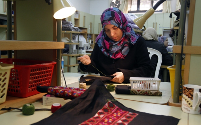 A deaf Palestinian woman embroids a piece of cloth as a part of the deaf adult education program at the Atfaluna Society for Deaf Children in Gaza City, on March 7, 2013 on the eve of International Women's Day. Click to see what other women around the world are up to as some prepare for this international event.