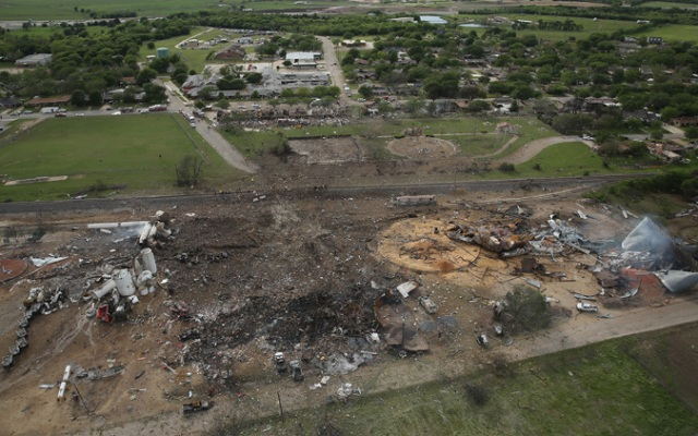 The West Fertilizer Company, shown from the air, lies in ruins on April 18, 2013 in West, Texas. According to West Mayor Tommy Muska, around 14 people, including 10 first responders, were killed and more than 150 people were injured when the fertilizer company caught fire and exploded, leaving damaged buildings for blocks in every direction.  (Photo by Chip Somodevilla/Getty Images)