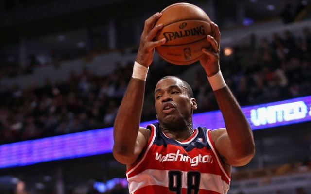 Jason Collins #98 of the Washington Wizards rebounds against the Chicago Bulls at the United Center on April 17, 2013.