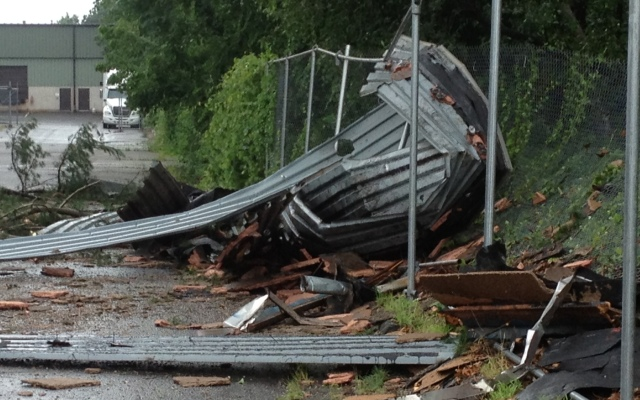 Monday's tornado tore metal roofing off a vacant warehouse building on Hayden Station Road, flinging the roofing into the back parking lot and nearby woods.