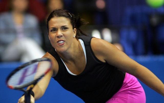 In this file photo from Nov. 3, 2004, Jennifer Capriati stretches for the ball during her second-round  match with Meghann Shaughnessy at the Advanta Championships in VIllanova, Pa.