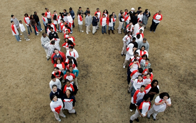 Students from the Maurice J. Tobin School makes a human Pi symbol at the school in Boston, Tuesday, March, 13, 2007, during a celebration of Pi Day. Pi Day is an unofficial holiday in the math community, observed each year on the 14th day of the third month.