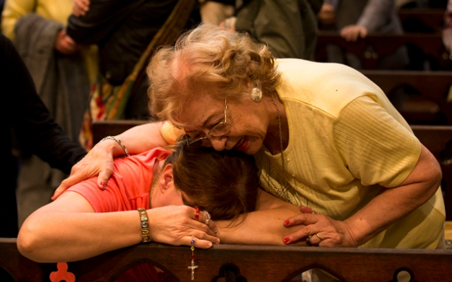 Women react after hearing on the speakers at the Metropolitan Cathedral that Buenos Aires' Archbishop Jorge Bergoglio was chosen as Pope in Buenos Aires, Argentina, Wednesday, March 13, 2013. Bergoglio is the first pope ever from the Americas and the first from outside Europe in more than a millennium. (AP Photo/Victor R. Caivano)