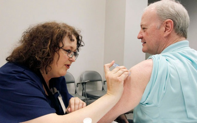 The CDC's new report shows that this year's flu outbreak continues to spread, but that the virus my be on the wane.