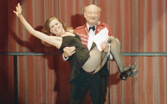 FILE - In this March 8, 1987, file photo, New York Mayor Ed Koch gives a lift to Broadway dancer Ann Reinking during a performance of political satire on at the annual Inner Circle gathering of the New York Press Club in New York. Koch, the combative politician who rescued the city from near-financial ruin during three City Hall terms, has died at age 88. Spokesman George Arzt says Koch died Friday morning of congestive heart failure.