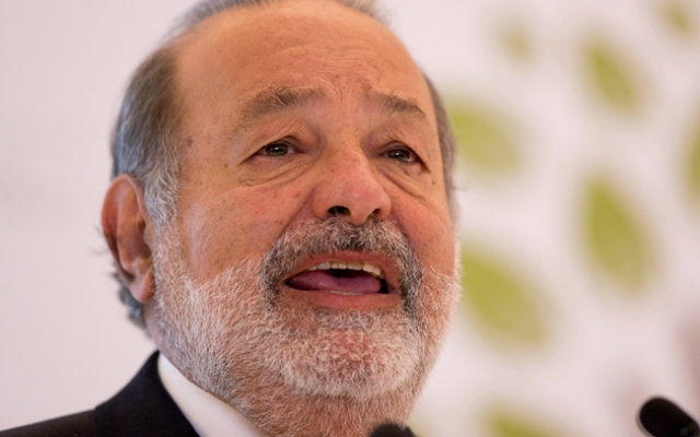 Mexican telecommunications tycoon Carlos Slim speaks during news conference at the Soumaya museum in Mexico City. Forbes magazine says Monday, March 4, 2013, that Mexico's Carlos Slim remains the world's richest man for the fourth year in a row, while Warren Buffett dropped out of the top three for the first time since 2000.