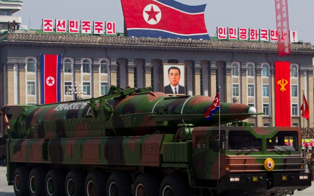 FILE - In this Sunday, April 15, 2012 file photo, a North Korean vehicle carries a missile during a mass military parade in Pyongyang's Kim Il Sung Square to celebrate the centenary of the birth of the late North Korean founder Kim Il Sung. Though it remains a highly unlikely scenario, Japanese officials have long feared that if North Korea ever decides to play its nuclear card it has not only the means but several potential motives for launching an attack on Tokyo or major U.S. military installations on Japan's main island. And while a conventional missile attack is far more likely, Tokyo is taking North Korea's nuclear. (AP Photo/David Guttenfelder, File)
