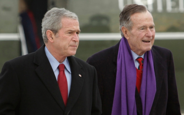 In this Dec. 26, 2008 file photo, President George W. Bush walks with his father, former President George H.W. Bush, at Andrews Air Force Base, Md. The younger Bush topped the list in 2012 for the highest expenses paid for by taxpayers.