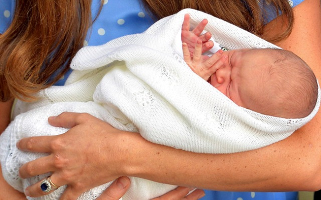 Kate, the Duchess of Cambridge, carries her new born son, the Prince of Cambridge, who was born on Monday. into public view for the first time. outside the Lindo Wing of St. Mary's Hospital, in London, Tuesday, July 23, 2013. The boy will be third in line to the British throne.  (AP Photo/John Stillwell, Pool)
