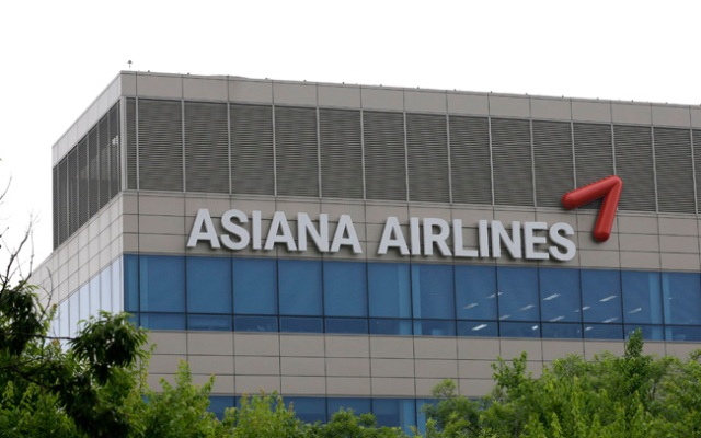 Asiana Airlines' logo is seen at its head office in Seoul, South Korea, Sunday, July 7, 2013. The airline won't sue San Francisco TV station KTVU over the fake racist pilot names its anchor read on the air last week, a spokeswoman said Wednesday.