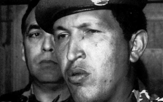 The leader of the Bolivarian Revolution 2000, officer Hugo Chavez, talks to reporters at the Defense Ministry after he surrendered to the troops loyal to the government of Carlos Andres Perez, in Caracas, Venezuela, this Feb. 4, 1992, photo. Chavez assumed Venezuela's presidency in 1999, vowing to eradicate corruption and the poverty that afflicts 80 percent of Venezuela's 24 million people. He was ousted Friday, April 12, 2002, at age 47. (AP Photo/Ali Gomez)