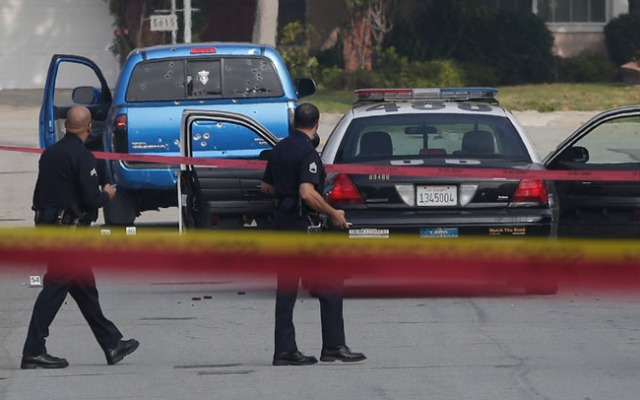 Feb. 7, 2013: Law enforcement officers look over the scene of an officer-involved shooting in Torrance, Calif.