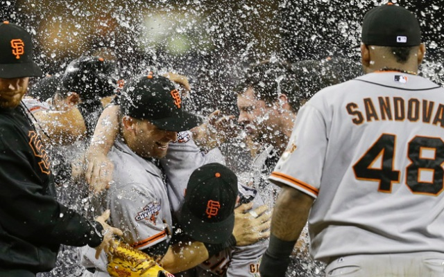 San Francisco Giants starting pitcher Tim Lincecum is bent over as water hits the crowd of Giant players celebrating Lincecum's no hitter over the San Diego Padres in a baseball game in San Diego, Saturday, July 13, 2013.  Tim Lincecum has thrown his first career no-hitter and the second in the majors in 11 days, a gem saved by a spectacular diving catch by right fielder Hunter Pence in the San Francisco Giants' 9-0 win against the last-place San Diego Padres on Saturday night.