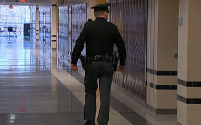 Enfield school officials voted to put armed guards in schools.