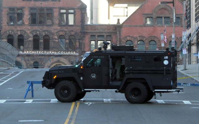 BOSTON - APRIL 16: A SWAT team vehicle stands guard on Dalton Street near Boylston Street on April 16, 2013 in Boston, Massachusetts. Security is especially tight in the city of Boston after two explosions went off near the finish of the Marathon, killing three people and injuring at least 141 others. (Photo by Darren McCollester/Getty Images)