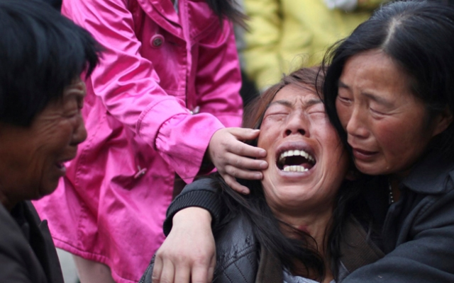 China Fire: A family member of a worker cries near the accident site after a fire broke out at a poultry processing workshop on June 3 in Dehui City. The blaze killed at least 119 people in one of the country's worst industrial disasters in years. Click to see more photos from May 31 to June 7.
