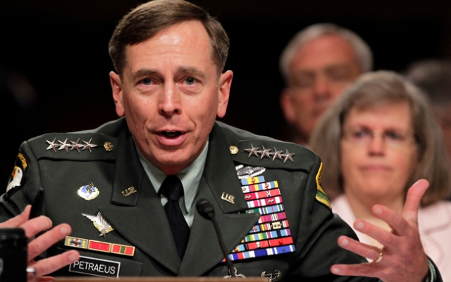 Gen. David Petraeus is expected to give a speech at USC on Tuesday, March 26, 2013. In this photo, he testifies on Capitol Hill in Washington, Tuesday, June 29, 2010, before the Senate Armed Services Committee hearing to be confirmed as President Obama's choice to take control of forces in Afghanistan. At right is his wife, Holly Petraeus.
