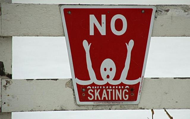 no skating/swimming sign from Feather Sound