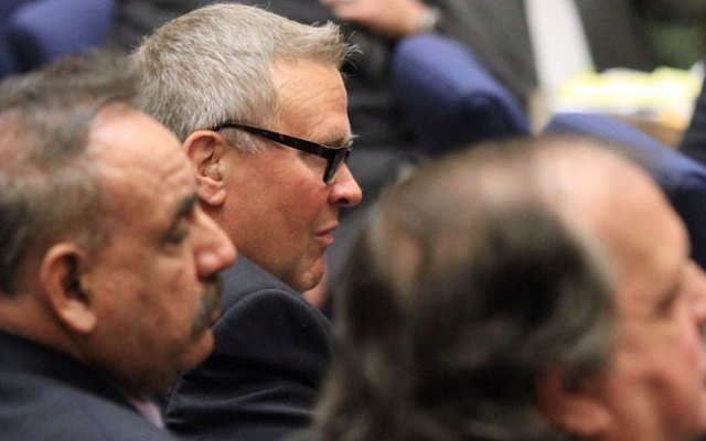 George Cole, center, a former Bell City Council member, listens to the judge as a guilty verdict is read in his trial on Wednesday, March 20, 2013, in Los Angeles. Cole and four former elected officials Bell were convicted of multiple counts of misappropriation of public funds, and a sixth defendant was cleared entirely.