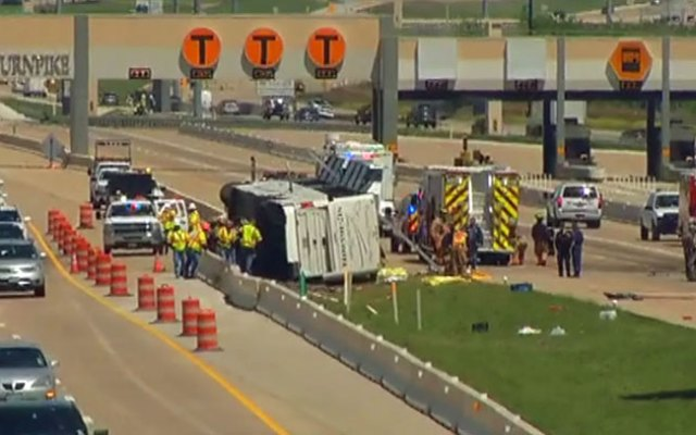 Investigators continue to comb through the wreckage of a bus involved in a deadly crash on state Highway 161 near Belt Line Road Thursday morning.