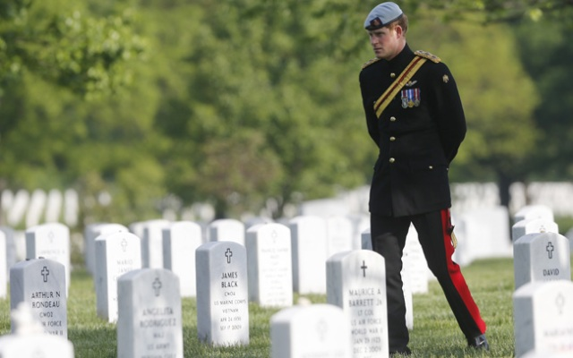 Prince Harry, a captain in the British Army who just returned from a tour of duty in Afghanistan as a helicopter pilot, visited Arlington National Cemetery May 10 as part of the 28-year-old's week-long visit to the U.S.
