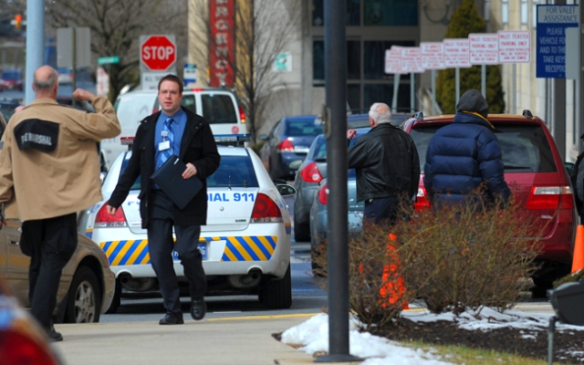 Allentown Police are on the scene of a murder-suicide at Lehigh Valley Hospital in Allentown, Pa., Tuesday, March 19, 2013. An elderly man shot and killed his 83-year-old wife in a hospice unit at the hospital, then turned the gun on himself, authorities said. (AP Photo/The Express-Times, Matt Smith)