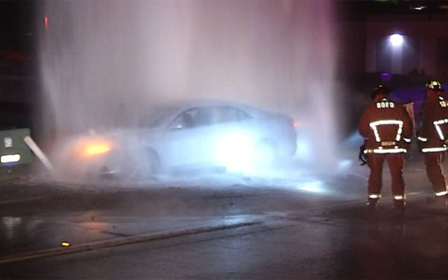 A driver was trapped for more than an hour after his car slammed into a hydrant.