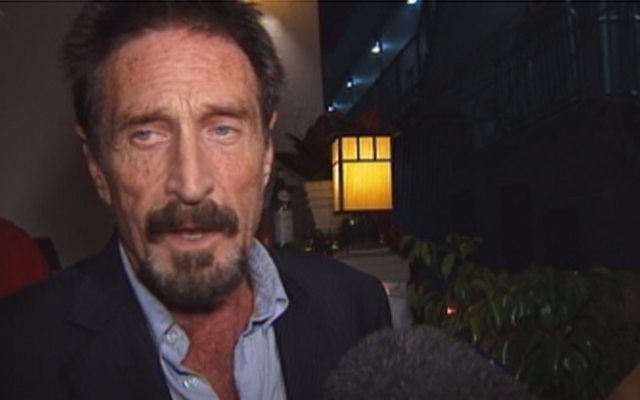 John McAfee spoke with reporters at the Beacon Hotel in South Beach Wednesday night.