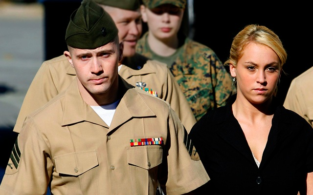 FILE - -In this Thursday Dec.7, 2006 file photo, Marine Corps Sgt. Lawrence Hutchins, 22, of Plymouth, Mass., left, leaves his arraignment hearing with his wife Reyna Hutchins at Camp Pendleton Marine Corps Base, Calif. Defense lawyer Babu Kaza said Tuesday, Feb. 15, 2011 that  the Marine Corps told his team that Hutchins would be returning to the brig to serve out the remaining five years of his sentence after a military high court reinstated his Iraq murder conviction. Hutchins, along with six other Marines and a Navy corpsman were charged with kidnapping and killing an Iraqi man last April in the town of Hamdania, Iraq. (AP Photo/Denis Poroy,File)