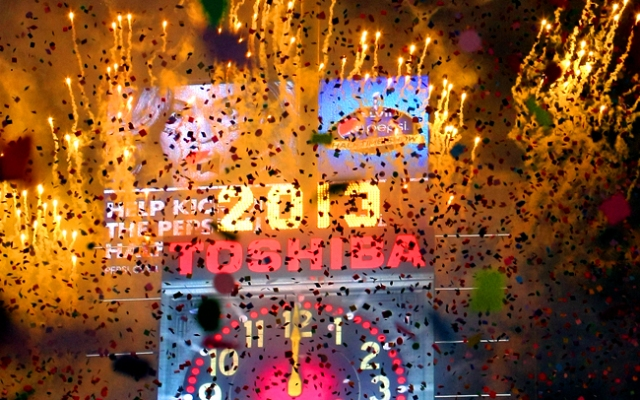 NEW YORK, NY - JANUARY 1: Fireworks explode at the stroke of midnight in Times Square on January 1, 2013 in New York City. Approximately one million people are expected to ring in the new year in Times Square. (Photo by Monika Graff/Getty Images)