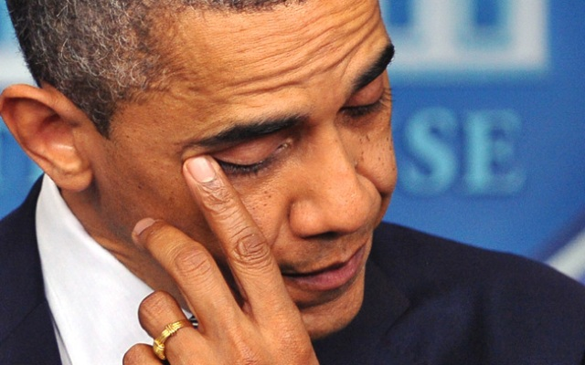 US President Barack Obama wipes his eye as he speaks during a previously unannounced appearance in the Brady Briefing Room of the White House on December 14, 2012 in Washington, DC. Obama spoke following the shooting in a Connecticut Elementary School which left at least 27 people dead.   AFP PHOTO / Mandel NGAN        (Photo credit should read MANDEL NGAN/AFP/Getty Images)