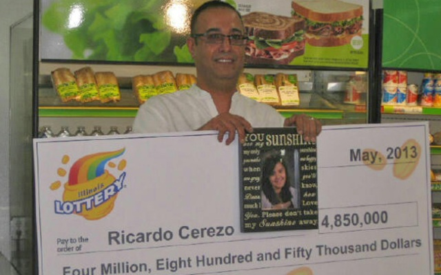 Ricardo Cerezo picks up his winnings, which he considers a gift from his late daughter Savannah.